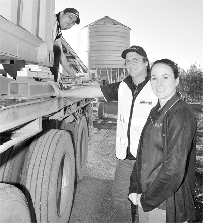 Wimpak's Todd Krahe and Sarah Spicer (right) show off their efficent container scales with plant operator Brock Tait (left).
